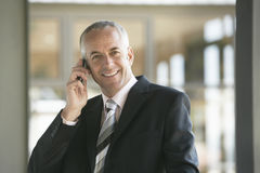 Happy Businessman Using Mobile Phone Royalty Free Stock Image