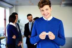 Happy businessman using smartphone Stock Image