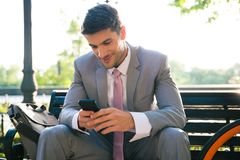 Happy businessman using smartphone outdoors Royalty Free Stock Images