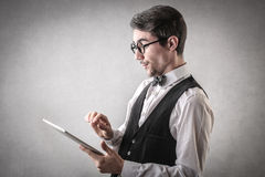 Happy businessman using a tablet. A happy businessman using a tablet Stock Photos