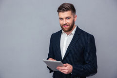 Happy businessman using tablet computer Stock Photos