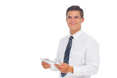 Happy businessman using tablet and looking at camera Stock Photo