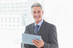 Happy businessman using tablet pc Stock Images
