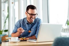 Happy businessman video calling his family while on a lunch break royalty free stock photos