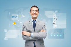 Happy businessman with virtual screens Stock Photos