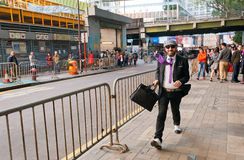 Happy businessman walking on busy business area of huge asian city Royalty Free Stock Image
