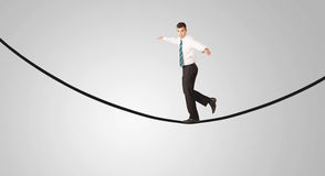 Happy businessman walking on rope Stock Photo