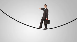 Happy businessman walking on rope Stock Photography