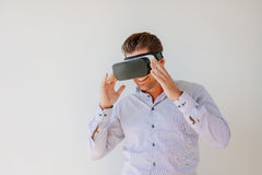 Happy businessman watches content on a virtual reality display Stock Image