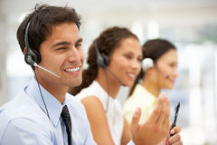 Happy businessman wearing headset Royalty Free Stock Photography