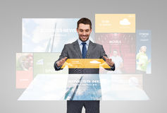 Happy businessman with weather forecast app Stock Images