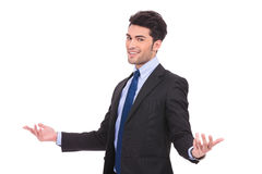 Happy businessman welcoming Stock Photography