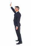 Happy businessman well dressed waving Stock Photography