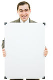 Happy businessman with a white board. On a white background Stock Images