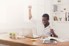 Happy businessman win. Winner, black man in office Stock Photo