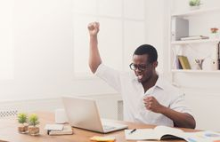 Happy businessman win. Winner, black man in office Stock Images