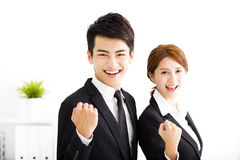Happy businessman and woman standing  in office Stock Image