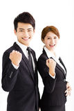 Happy businessman and woman standing  in office Royalty Free Stock Images