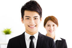 Happy businessman and woman standing  in office Royalty Free Stock Image