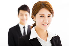 Happy businessman and woman standing  in office Stock Photography
