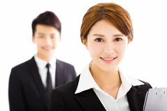Happy businessman and woman standing  in office Royalty Free Stock Photography