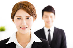 Happy businessman and woman standing  in office. Happy business men and women standing  in office Stock Photo