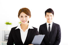 Happy businessman and woman standing  in office. Happy business men and women standing  in office Stock Photography
