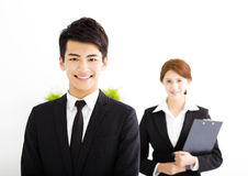 Happy businessman and woman standing  in office Royalty Free Stock Photos