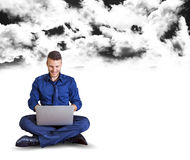 Happy businessman at work below black clouds Royalty Free Stock Images
