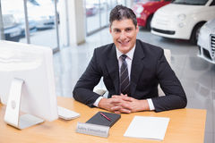 Happy businessman working at his desk Stock Photos