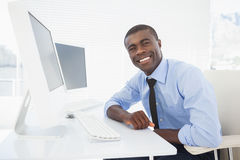 Happy businessman working at his desk Stock Photography