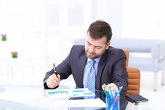 Happy businessman is working in his office. Royalty Free Stock Image