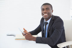 Happy businessman working with his tablet Royalty Free Stock Photos