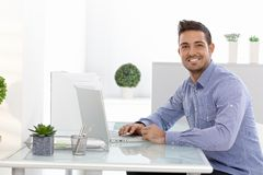 Happy businessman working on laptop Royalty Free Stock Photography