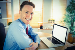 Happy businessman working with laptop Royalty Free Stock Photo