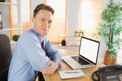 Happy businessman working with laptop Stock Photos