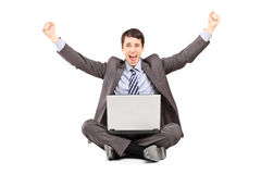 Happy businessman working on a laptop Royalty Free Stock Photography