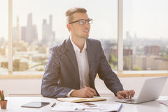 Happy businessman working on project Stock Images