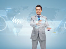 Happy businessman working with virtual screens Stock Images