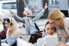 Happy businessman at workplace Stock Photos