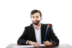 Happy businessman writing in the office Stock Photos