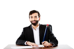 Happy businessman writing in the office Stock Images
