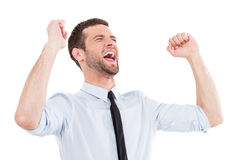 Happy businessman. Happy young man in shirt and tie expressing positivity and gesturing while standing isolated on white stock images