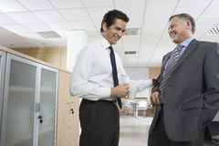 Happy Businessmen Communicating In Office Royalty Free Stock Image