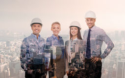 Happy businessmen in helmets over city background Royalty Free Stock Photography