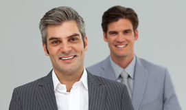 Happy Businessmen in a line Royalty Free Stock Image