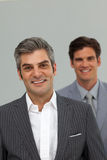 Happy businessmen in a row Stock Images