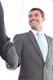 Happy businessmen shaking hands Stock Image