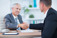 Happy businessmen shaking hands Stock Images