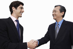Happy businessmen shaking hands over white background Royalty Free Stock Photos
